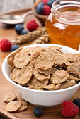 Cereal flakes, milk and honey for breakfast, close-up — Stock Photo