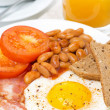 English breakfast with fried eggs, bacon, beans, toasts — Stock Photo