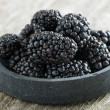 Bowl of fresh blackberries on wooden background — Stock Photo #46926463