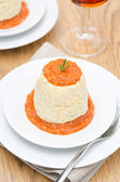 Mousse of chicken with pumpkin, green and red pepper sauce — Stock Photo