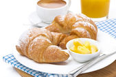 Croissants with butter, espresso and orange juice — Stock Photo