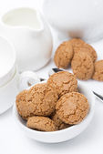 Italian cookies amaretti and crockery for teatime, vertical — Stock Photo
