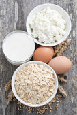 Fresh products-oatmeal, eggs, cottage cheese and milk, top view — Stock Photo