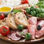 Assorted Italian antipasti - deli meats, fresh cheese, olives — Stock Photo #47886223