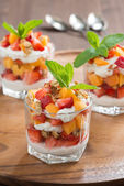 Fruit dessert with whipped cream and granola, vertical — Stock Photo