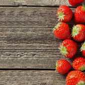 Square wooden background with fresh strawberries — Stock Photo