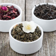 Assorted dry herbal teas in white bowls — Stock Photo