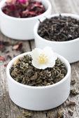 Assorted dry herbal teas in white bowls, close-up — Stock Photo