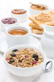 Muesli, coffee, jams, toast and peanut butter for breakfast — Stock Photo