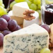 Assorted snacks and red wine, blue cheese, cheddar, camembert — Stock Photo #48930853