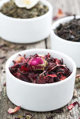 Dry herbal teas in white bowls, close-up — Stock Photo
