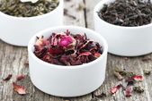 Dry herbal teas in white bowls — Stock Photo
