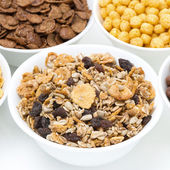 Granola and various breakfast cereals in bowls — Stock Photo