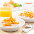 Постер, плакат: Plates of oatmeal with fresh apricots orange juice and tea