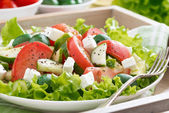 Plate of green salad with vegetables, close-up — Stock Photo