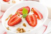 Dessert with whipped cream, granola and fresh strawberries — Stock Photo