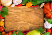 Wooden board for recipe, spices and fresh vegetables — Stock Photo