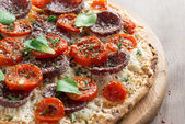 Italian pizza with salami and tomatoes, close-up — Stock Photo