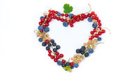 Assorted garden berries in a heart-shaped, top view, isolated — Stock Photo
