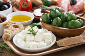 Antipasti platter - fresh feta cheese, deli meats, olives — Stock Photo
