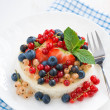 Mini cheesecake with fresh berries, top view — Stock Photo #50276735