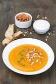 Plate of carrot soup with almonds and watercress — Stock Photo