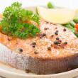 Baked salmon with asparagus and lemon on plate, close-up — Stock Photo #50914291