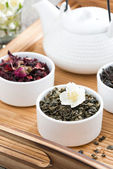 Dry herbal teas and kettle of freshly brewed tea — Stock Photo