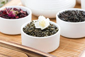 Dry herbal teas in white bowls on a tray — Stock Photo