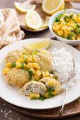 Fish cakes with mango salsa and white rice — Stock Photo