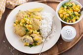 Fish cakes with mango salsa and white rice, top view — Stock Photo