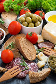Assortment of delicious antipasti, vertical — Stock Photo