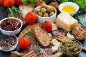 Assortment of delicious antipasti — Stock Photo