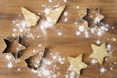 Christmas cookies and baking dish on a wooden board — Stock Photo