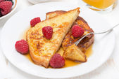 French toast with raspberries and maple syrup, top view — Stock Photo