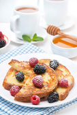 French toast with berries and powdered sugar for breakfast — Stock Photo