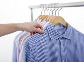 Hand shirt choose — Stock Photo