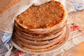 Turkish lahmacun (arab pizza) on plate — Stock Photo