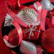 Stock Photo: Red and silver Christmas decoration in black bowl