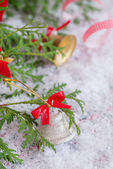 Christmas composition with silver bell decoration — Stock Photo