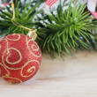 Royalty-Free Stock Photo: Red christmas ball and fir branches with decorations