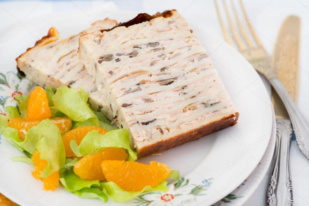 Chicken galantine stuffed with pancakes, meat and mushrooms — Stock Photo #18216015