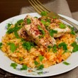Постер, плакат: Tomato pilaf with chicken and sumac
