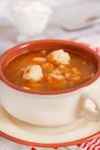 Soup with beans and dumplings in soup bowl — Stock Photo