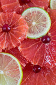 Citrus slices background - grapefruit and lime — Stock Photo