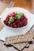 Salad with beetroot, potatoes, pickled cucumber and green peas — Stock Photo