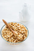 Bowl of puffed wheat cereal for breakfast — Stock Photo