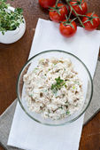 Smoked mackerel pate with eggs and herbs in glass bowl — Stock Photo