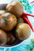 Kumato (brown) tomatoes in bowl — Stock Photo