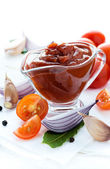 Homemade tomato ketchup with ingredients — Stock Photo